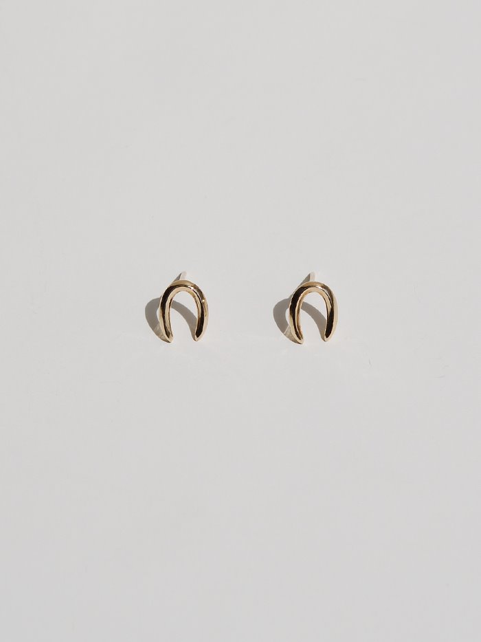 Tiny U gold earring