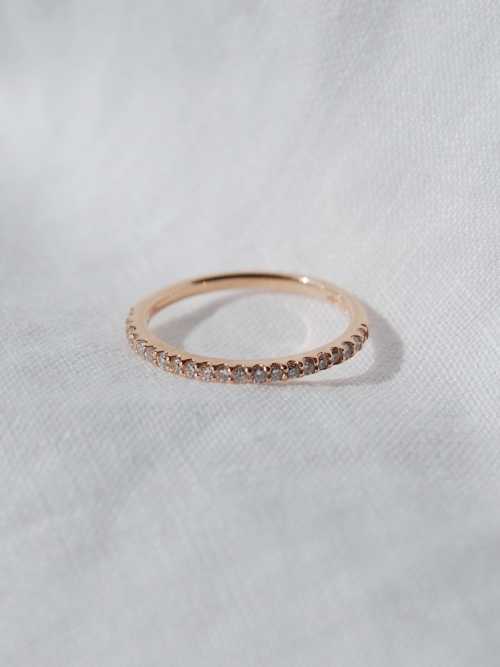 Thin half eternity diamond ring